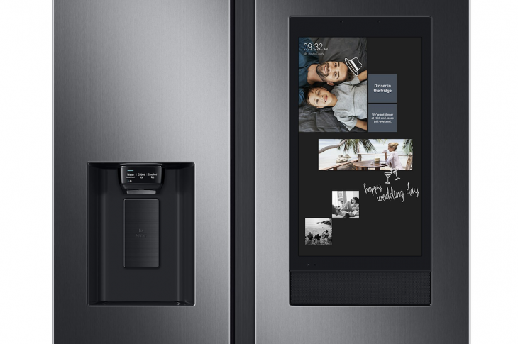 A close-up view of Samsung's Family Hub refrigerator door with screen and smart technology