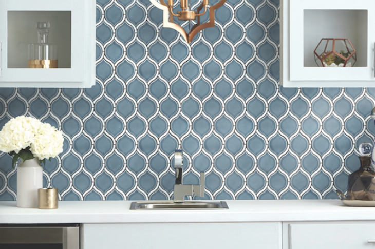 Inspired by Greek mythology, the Divine mosaic series from Emser Tile boasts clean, contemporary arabesque lines and a gloss finish. Dark-toned borders outline light neutrals and blue tiles, while white borders accent warmer blue and green tiles. The tiles are ideal for backsplashes, shower walls, or accent walls. IBS Booth C7237.