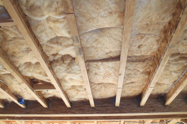 Insulation for an above-garage floor area