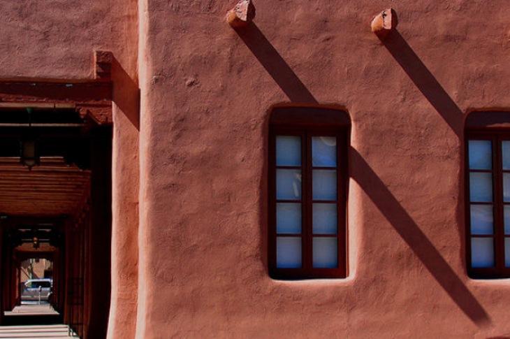 Stucco house deep window recess. Flickr user karol m