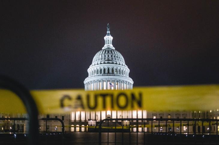 U.S. Capitol with yellow caution tape in front of it