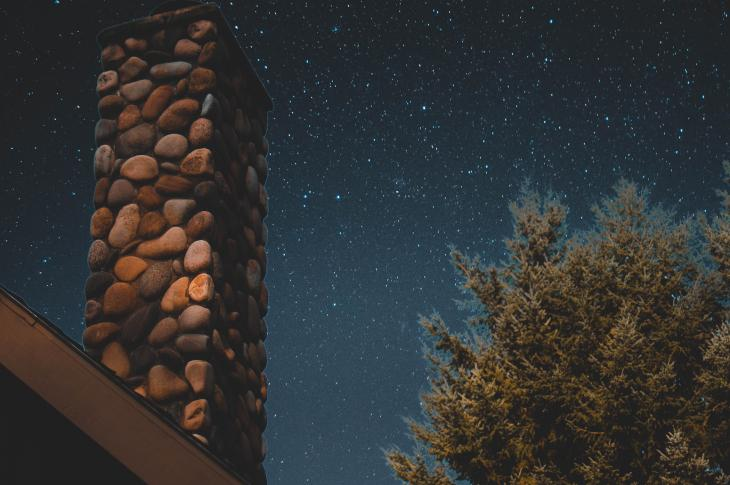 Chimney under night sky with stars