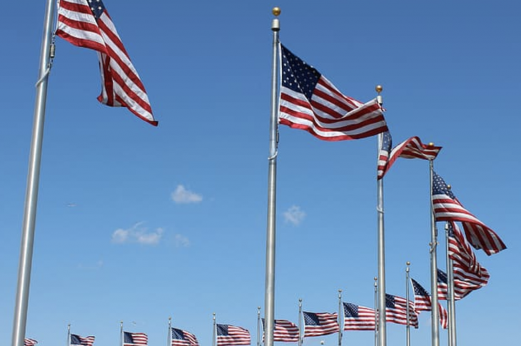 arc of American flags on flagpoles