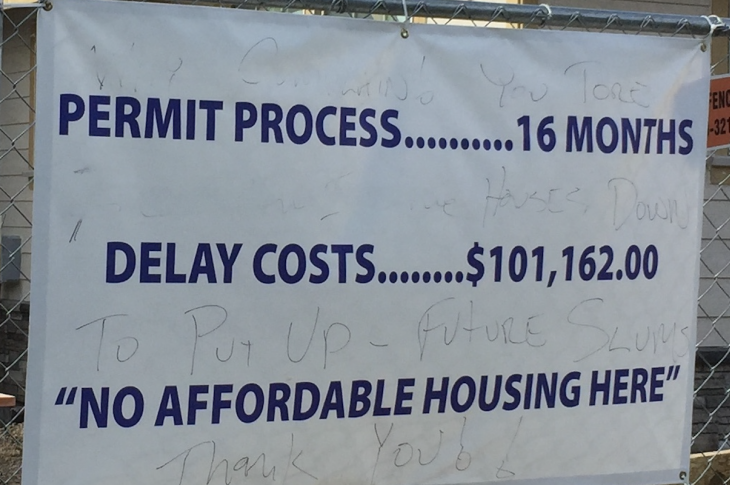 banner about no affordable housing here because costs are up due to regulations and delays