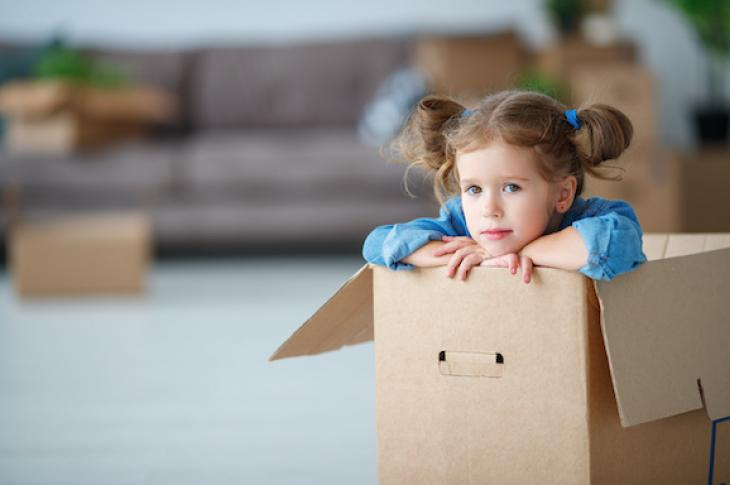 Child in moving box