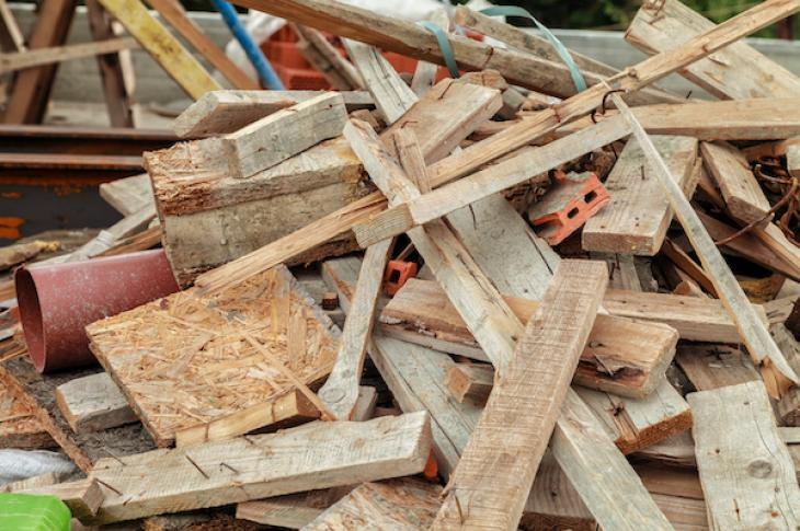 plywood, lumber, and other construction waste in a pile on the jobsite