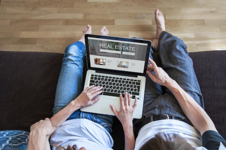 couple looking at homes online