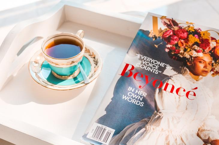 Breakfast tray with tea and Beyoncé cover of Vogue magazine September 2018 issue