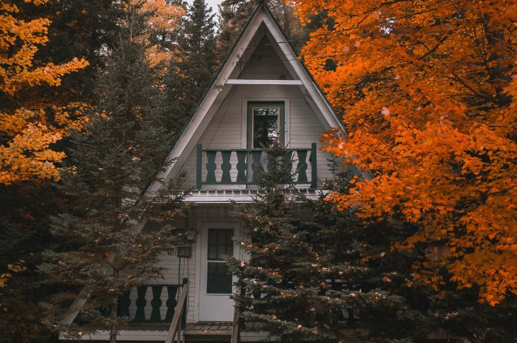 A-Frame home in the woods with colorful trees