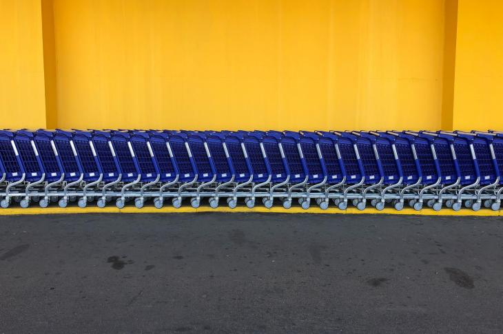 Shopping carts in front of yellow building