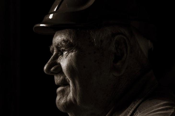aging construction worker wearing hardhat