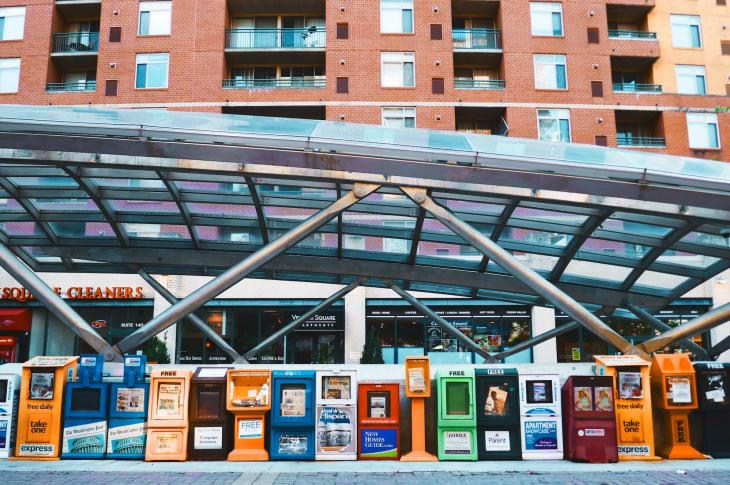 Newspaper vending units at a transit station