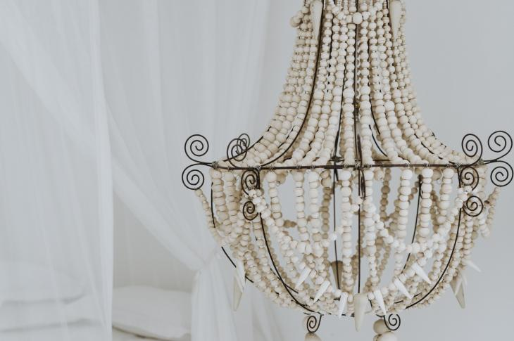 Chandelier in bedroom with bed