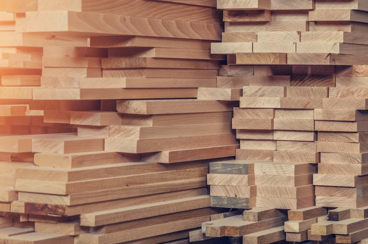 stacks of lumber planks and 2 by 4s