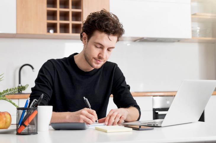 Man filling out Paycheck Protection Program (PPP) loan application