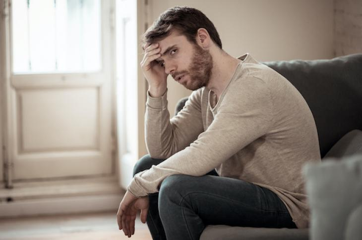 Man upset sitting at home