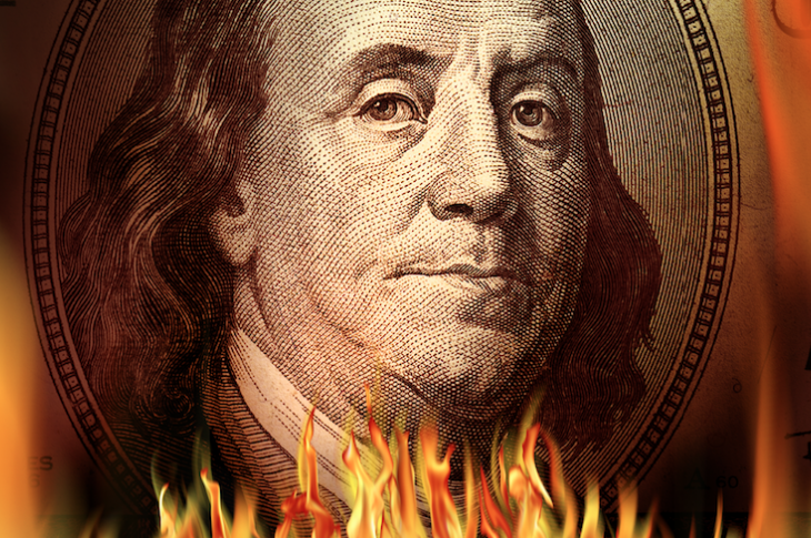U.S. $100 on fire shows waste of money and profits burning