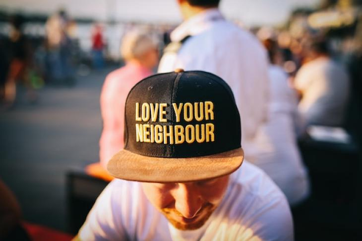 Man_wearing_Love_your_neighbor_cap