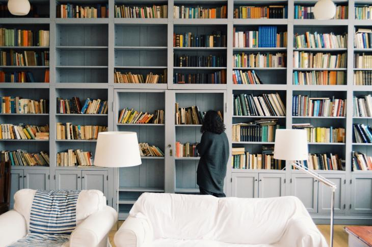 Woman at built-in bookcase