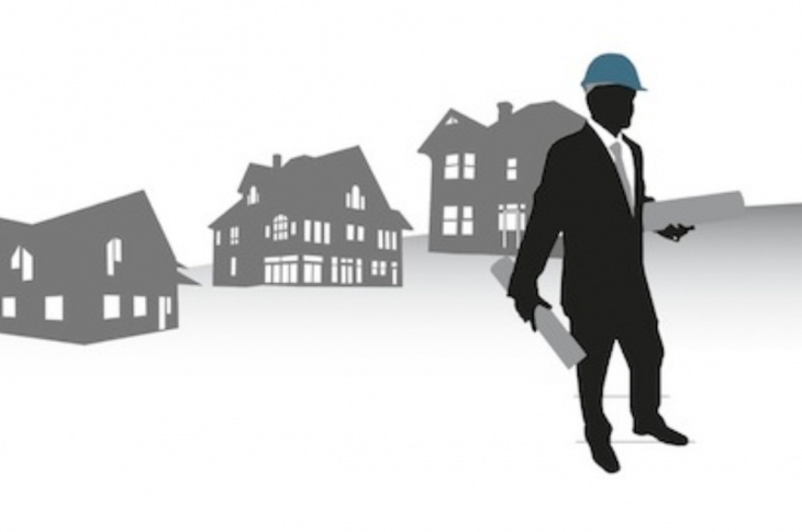 Silhouette of home builder wearing hard hat and holding house plans