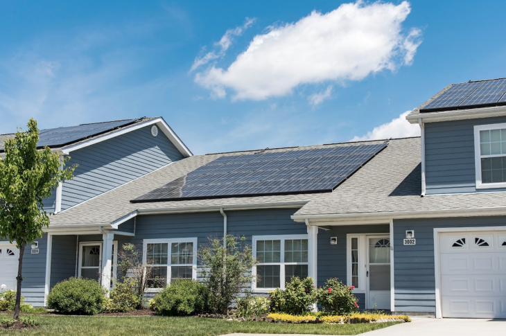 solar panels installed on home roof are an energy alternative that reduces fossil fuel use
