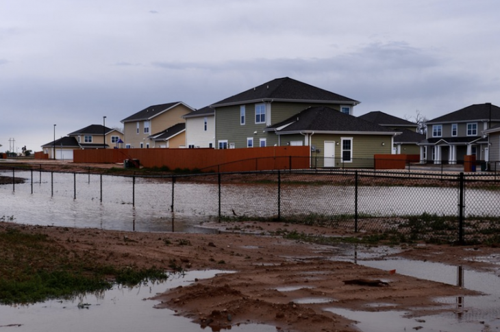 standing water around new homes after heavy rain