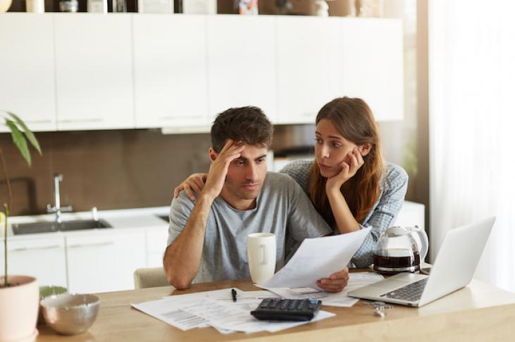 Unhappy Couple Crunching Numbers