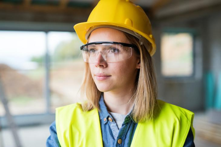 Woman looking determined at construction site