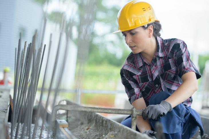 Woman working on a construction site