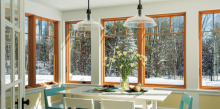 The large expanse of Andersen Windows in this kitchen connect the space to the outdoors