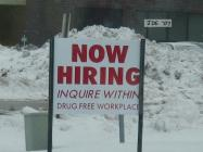 """Now hiring"" sign to attract new employees."