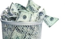 Trash can full of money to indicate lost revenue from process inefficiencies in the home building process.