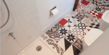 Colorful, whimsical floor tile makes this white bathroom by Studio Habeas Corpus pop. The project won a honorable mention in the Duravit Designer Dream Bath Competition.