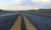Image of a road--employees are traveling farther to get to work, study finds.