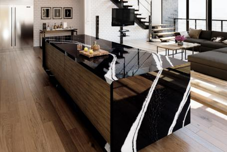 Cambria Mersey black quartz surfacing with white veining installed on kitchen island in modern home