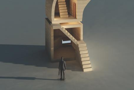 businessman looking at stairs leading to the future of his business as he plans for succession