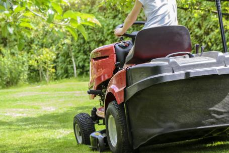 woman on riding mower