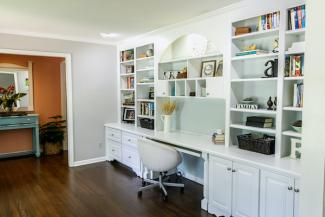 Home office with bookshelves spanning the wall