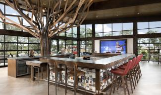 the Kissing Tree welcome center with its central bar wins a Nationals sales and marketing award