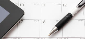 calendar and pen for scheduling home building business
