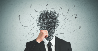 man with scribble for a head shows confusion and complexity at work