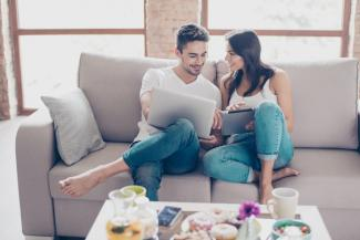Couple looking at home virtually