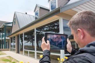 home builder using tablet for virtual inspection
