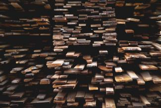 Planks_of_wood_stacked_in_shelves