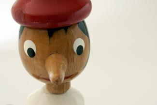 Pinocchio wooden figurine nose grows when he tells a lie