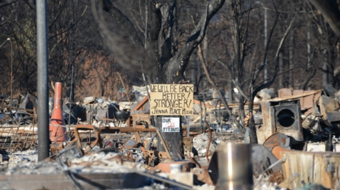 Debris and the rebuilding effort after wildfire in Coffey Park, California