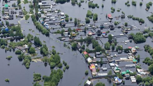 Aerial view of flooded homes, a natural disaster