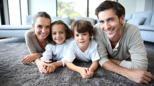 Family enjoying healthy indoor air quality in a net zero home