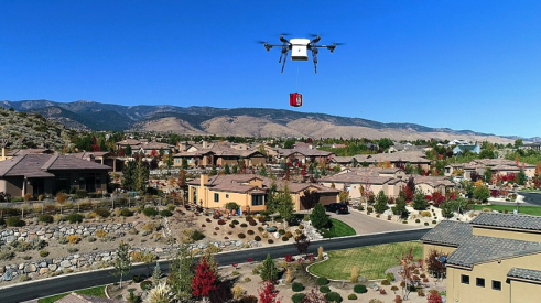 Drone delivering package to a home