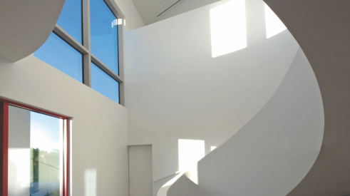 sculptural staircase design detail in a Sarasota custom home by Michael K. Walker & Associates